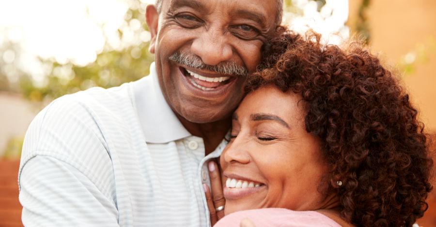 older couple smiling Melrose dental implants