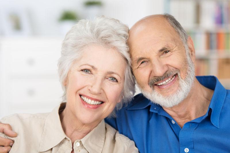 Older couple smiling | Dental bridges | Dental implants melrose