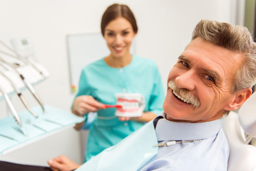 Melrose dental care | patient with dentist