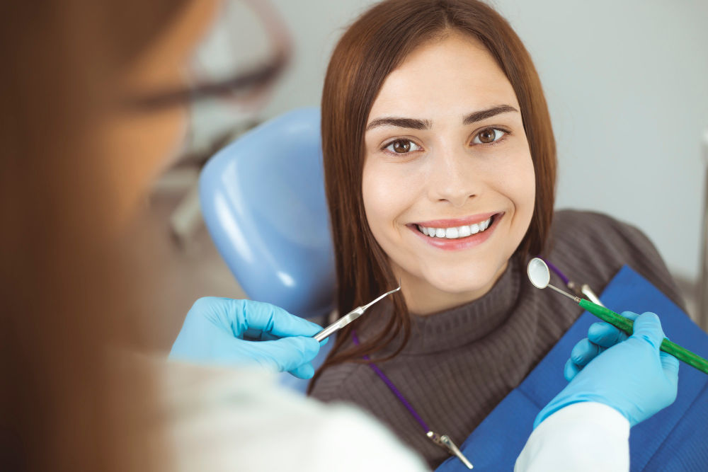 Dentist In Melrose | female patient smiling