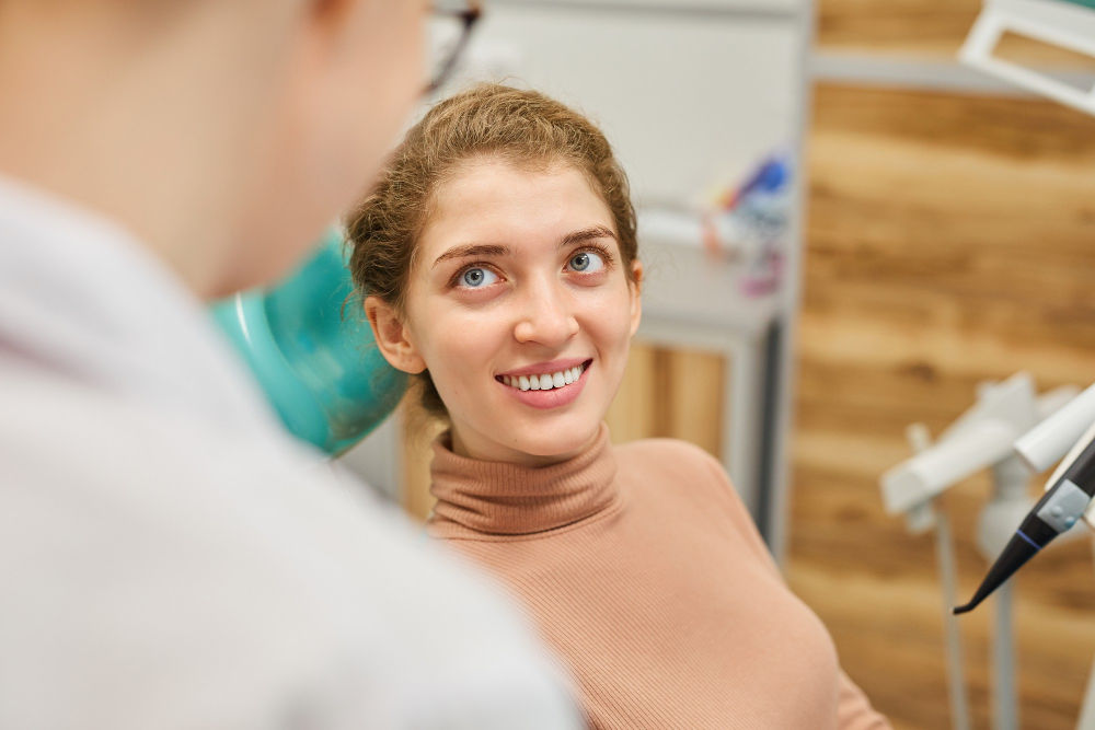 family dentist in Melrose MA | Woman smiling at dentist.